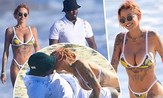 PICTURE EXCLUSIVE: Sean 'Diddy' Combs kisses Brian Austin Green's tattooed model ex Tina Louise